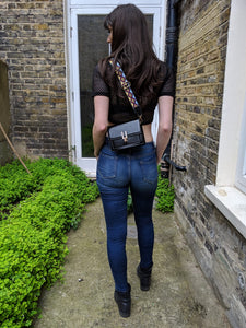 black over-the-shoulder bag.