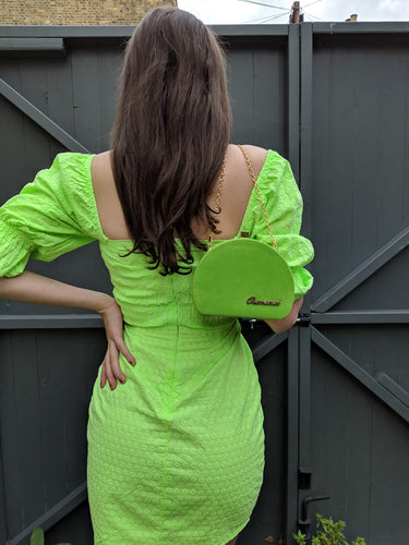 lime green shoulder bag.