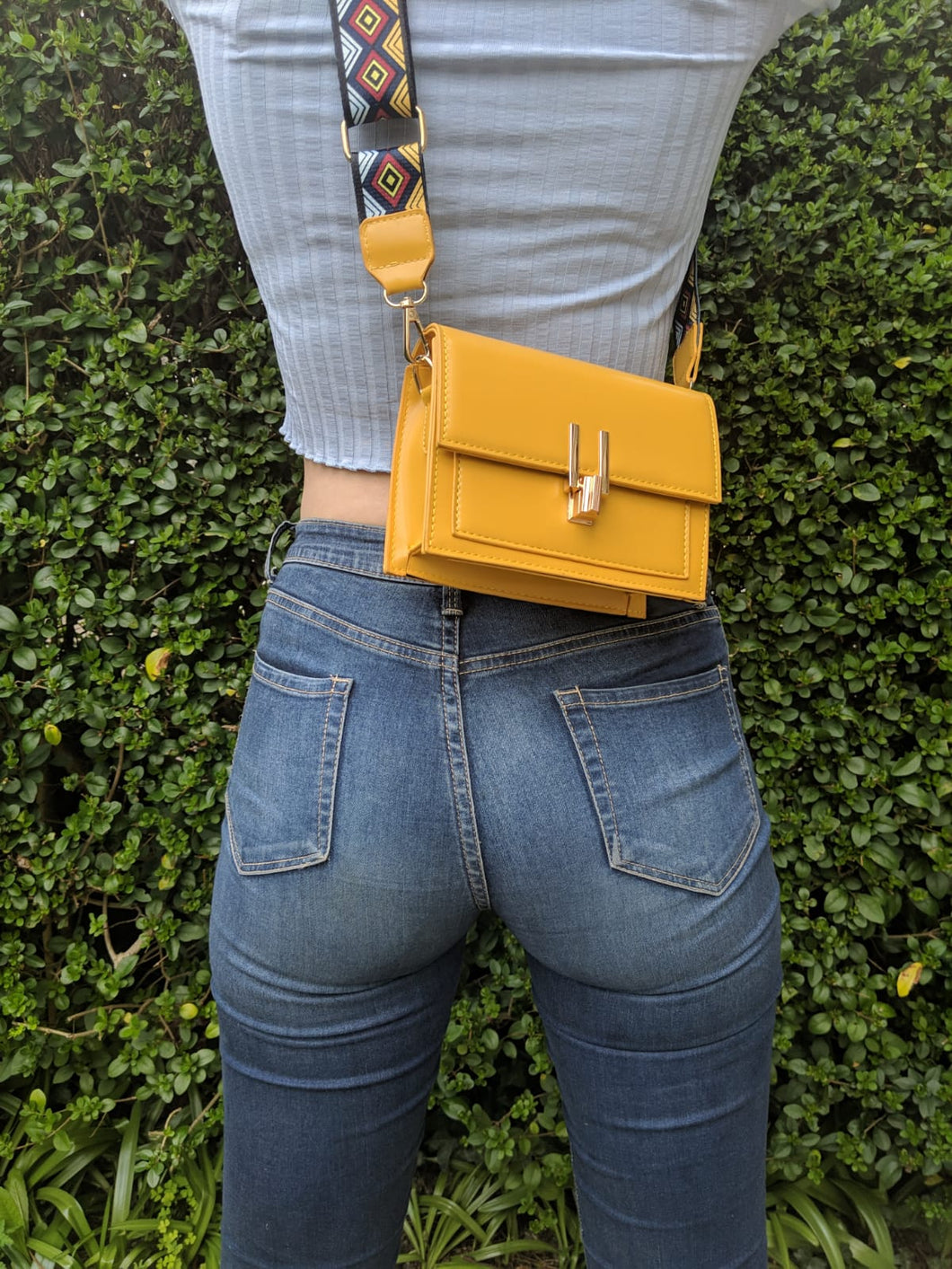 yellow over-the-shoulder bag.