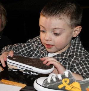 Jacob Tamme and Peach Deliver Evans Custom Shoes