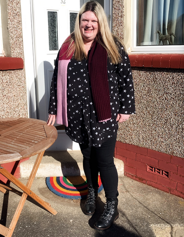 Lee in our Knitted Scarf in Rhubarb, Raspberry and Black