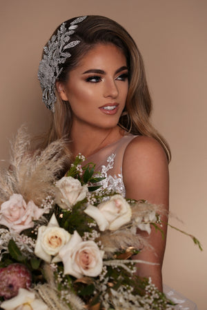 Beautiful Bride with Wedding Headdress and Flowers | Ellee Couture Boutique