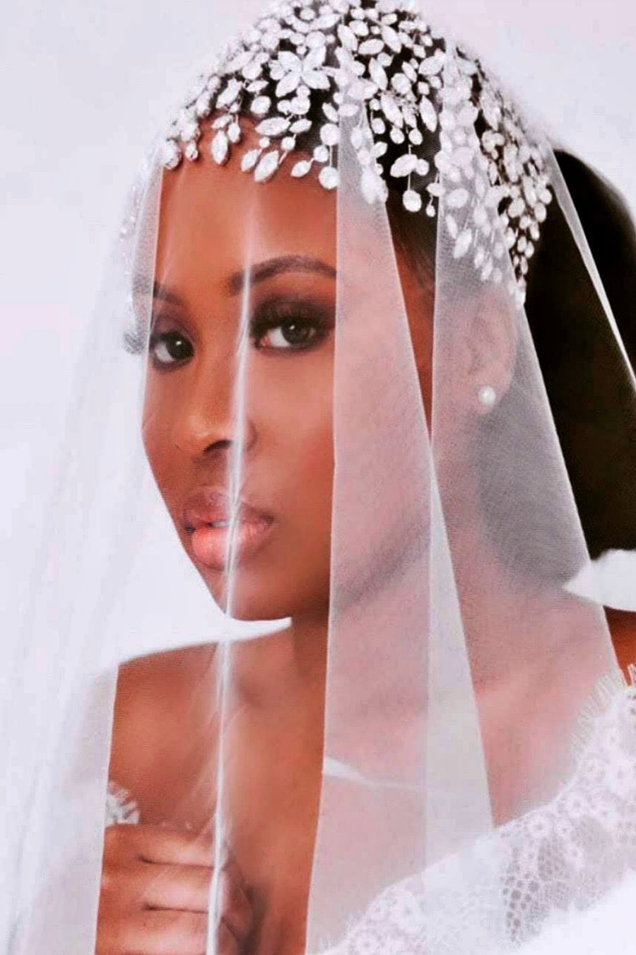 Bride with face veil wearing ADELE Wedding Headpiece from Ellee Couture Boutique
