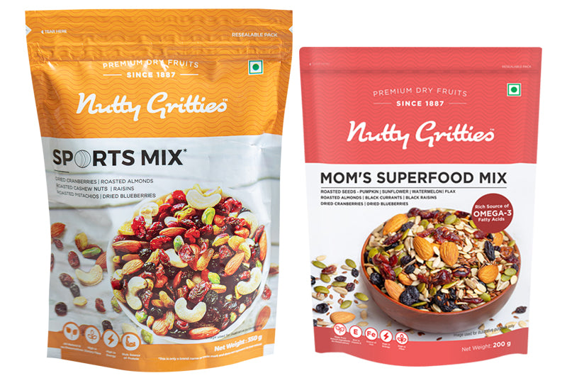 Nutty Gritties Diwali Gift Sports Mix 350g + Mom's Superfood Mix 200g + Darkins Roasted Almonds 70% Dark Chocolate + Diwali Greeting Card + Candles (Pack of 2)