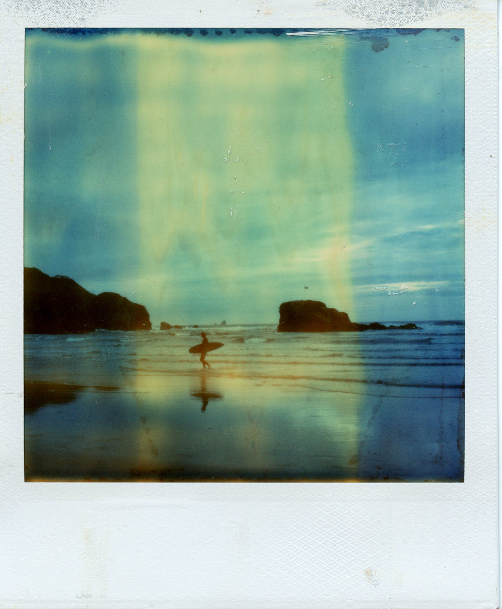 Polaroid image of a surfer and chapel rock reflections, Perranporth