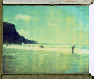 Polaroid image of Surfers and beach gazers at Porthtowan