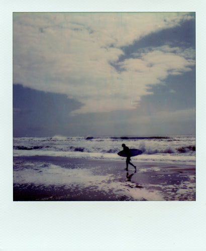 Polaroid of a surfer at Frisco, USA