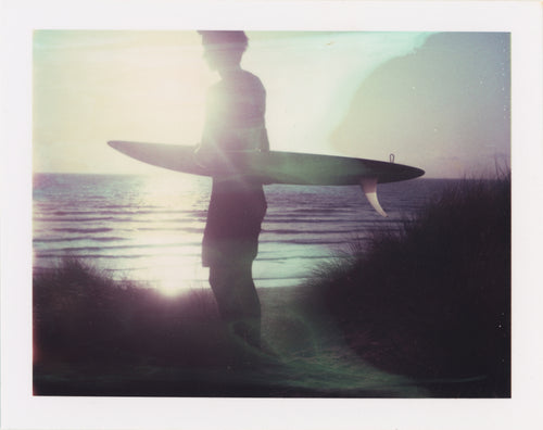 Polaroid of surfer at perran sands sunset