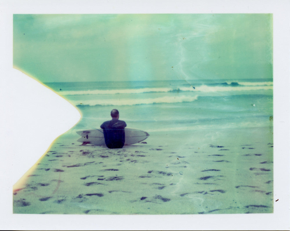 Polaroid image of a surfer with a twinfin at Sennen, Cornwall