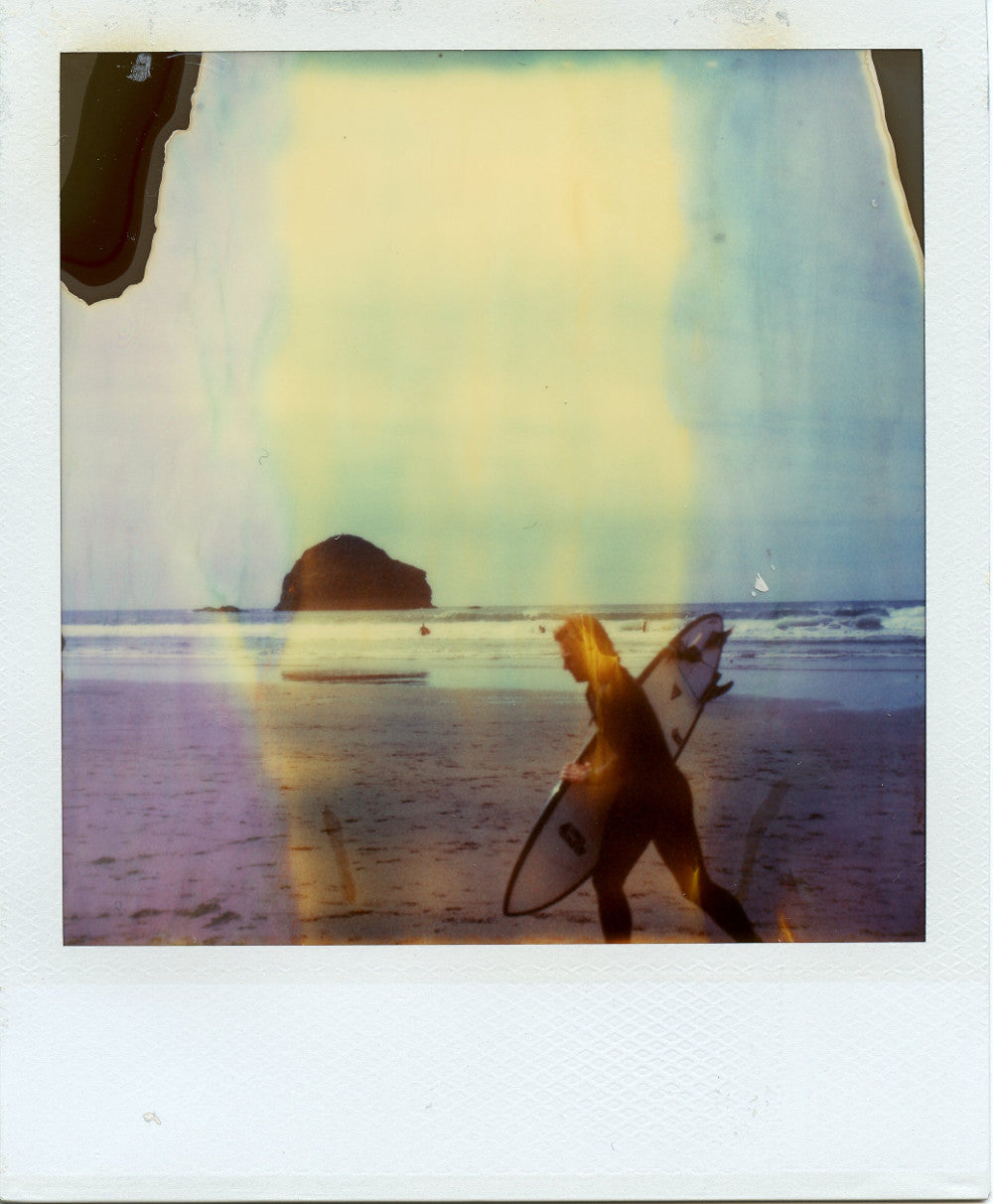 Polaroid image of a surfer at Trebarwith and Gull Rock in the distance