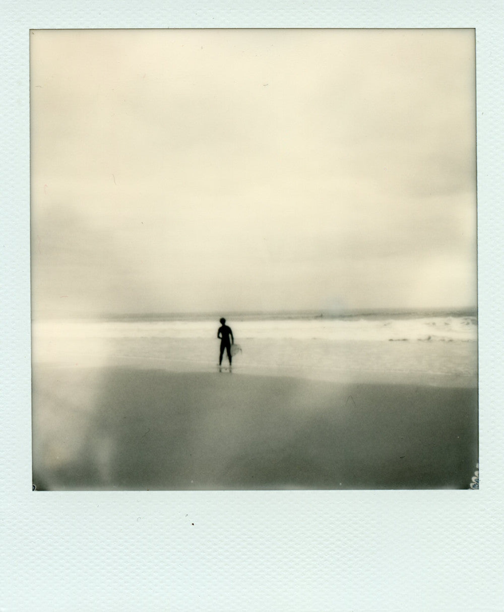 Black and white polaroid of a surfer at Chapel Porth