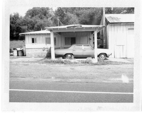 Polaroid image of car in a car port in America