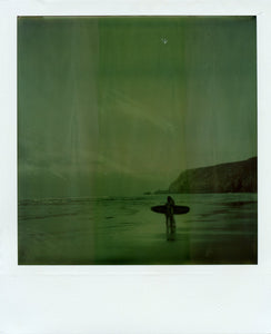 Polaroid image of people at the waters edge