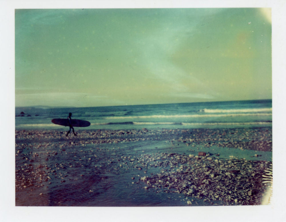 Polaroid of a longboarder at Porthtowan