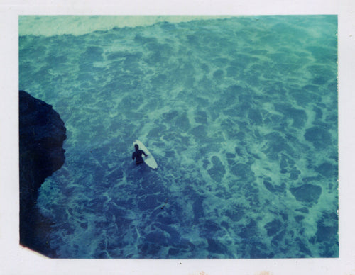 Polaroid image of a longboarder at St Agnes