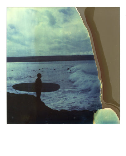 Polaroid image of a surfer at a pointbreak