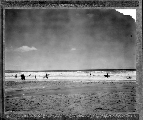 Polaroid of surfers at Porthtowan on a summers day