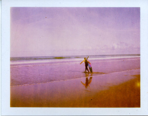 polaroid image of a longboard and reflection