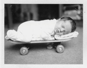 Polaroid image of child on skateboard