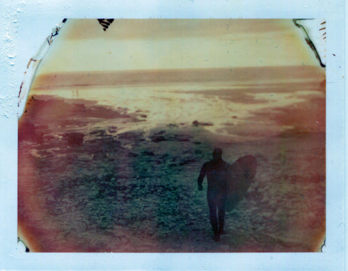 Polaroid image of a sunset and longboarder at chapel porth