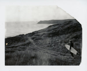 Polaroid image of a surfer in the dunes at Perran Sands