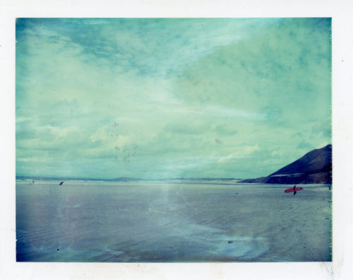 Polaroid of a longboarder at Rhosilli