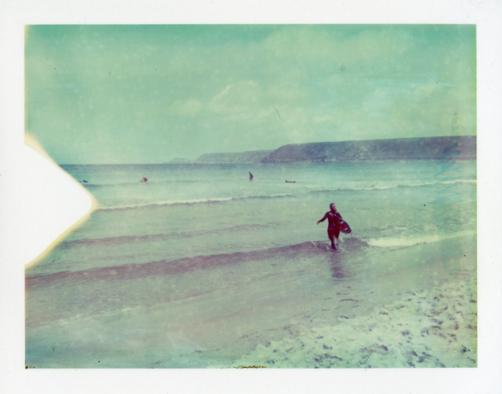 surfer on expired polaroid film at Sennen