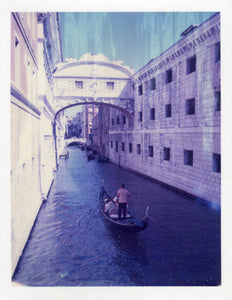 Polaroid of a gondola in a Venice canal