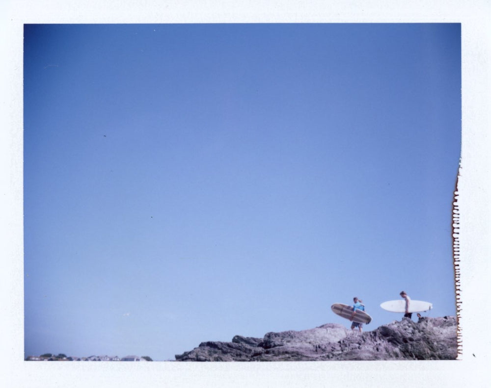 Surfers on tristram cliff shot on polaroid