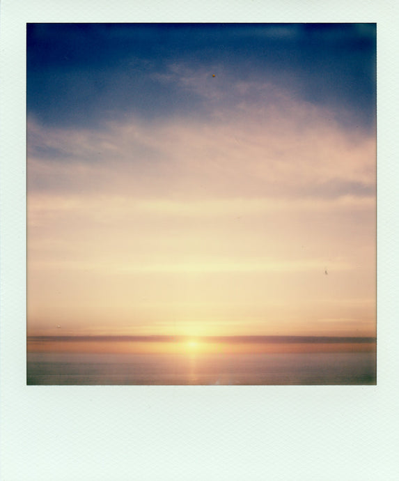 Polaroid of a sunset from St Agnes beacon