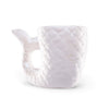 Beautiful white ceramic mug in the shape of a mermaid's tail
