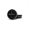 Sweet Dreams Solid Perfume in black circular tin container with white lettering