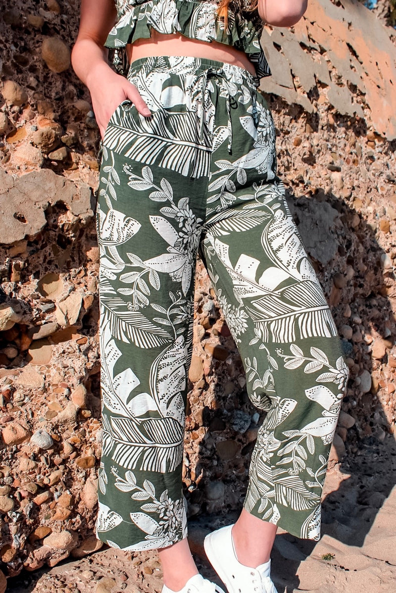 green and white leaf pattern cropped pants with adjustable drawstrings at waist