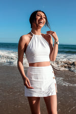 White linen set, halter top, skort with brown buttons