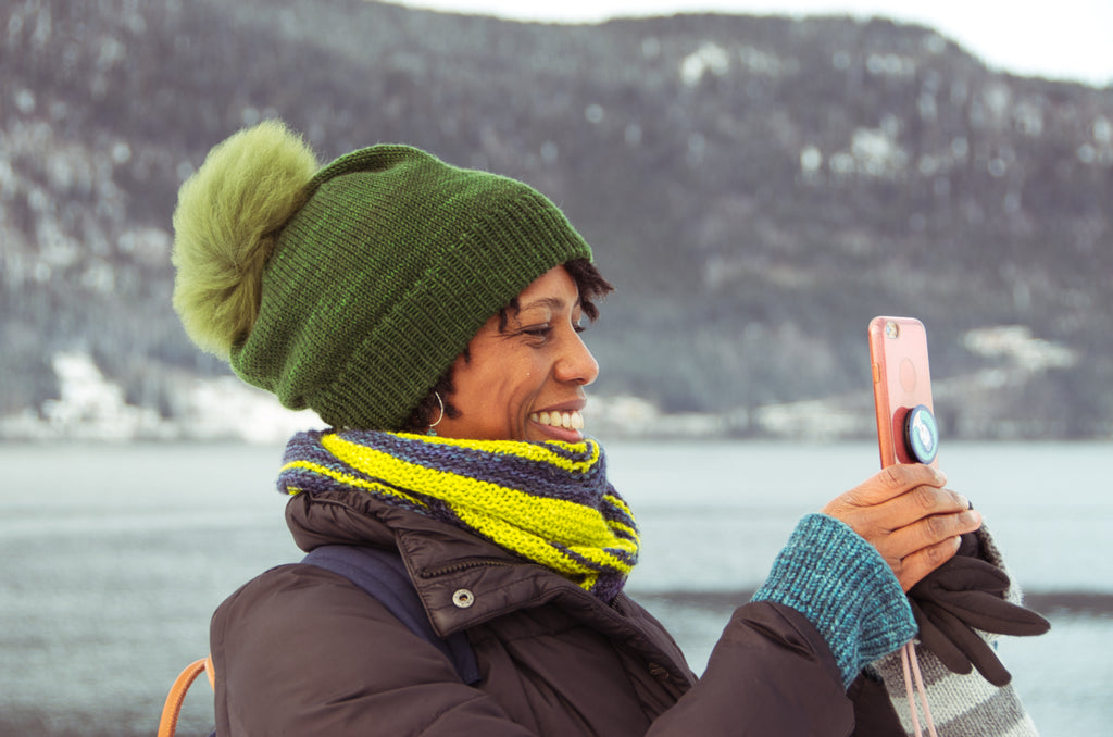 Jimi taking photos by the Fjord