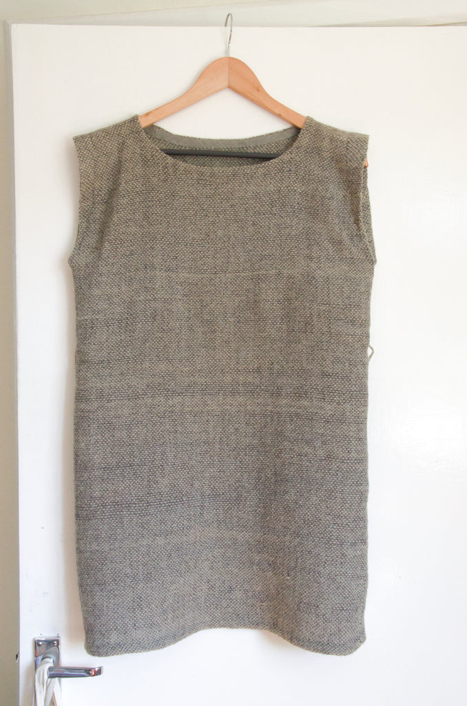 Dress made from hand-woven fabric on a hanger