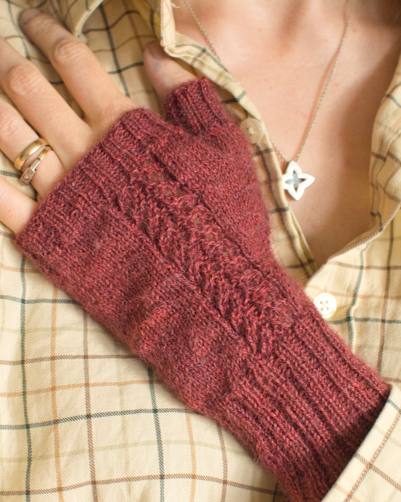 Wynsum fingerless mitts knit in Caia Baby Alpaca in Pandora – dark red yarn