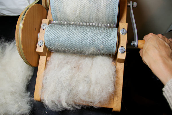 Carding wool on a drum carder