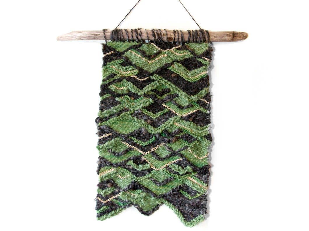 Geometric tapestry wall hanging in green, brown and gold