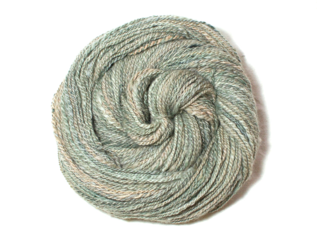 Serene – Hand-spun Pure Wool Yarn in sage green and peach (100g)