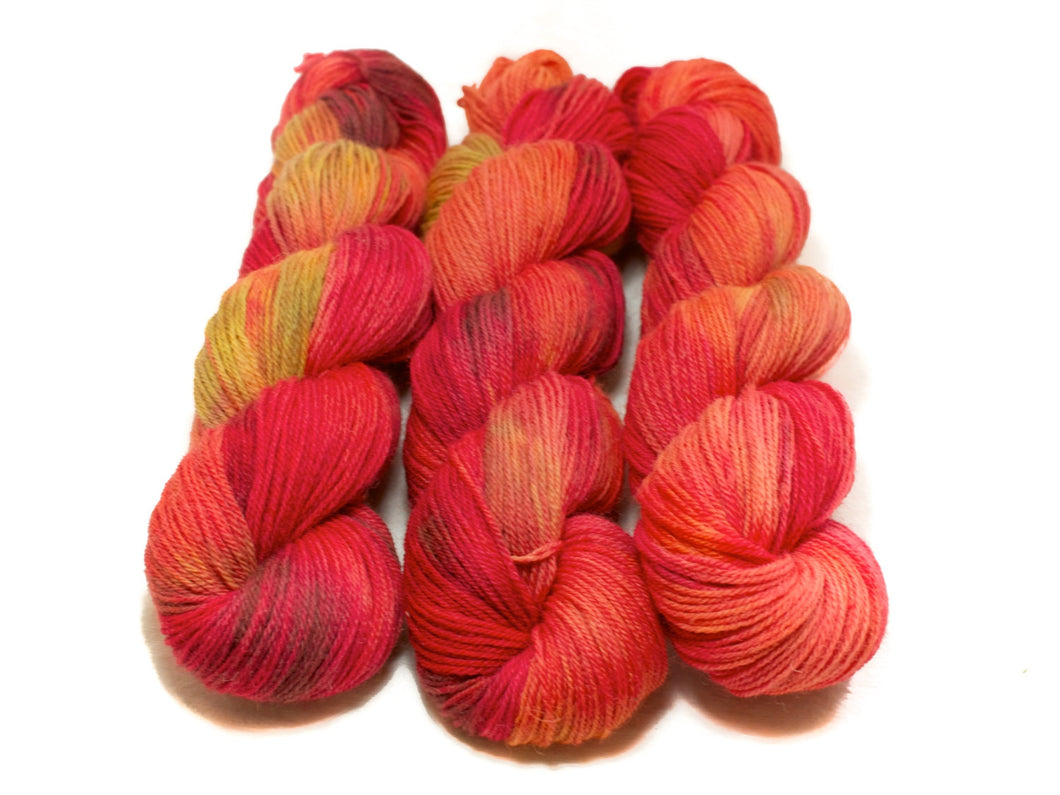 Tropical Sunset – Kent Romney DK in red, orange, yellow and brown
