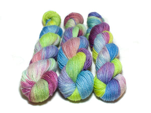 Rave – Bluefaced Leicester Fingering in green, blue, pink and yellow