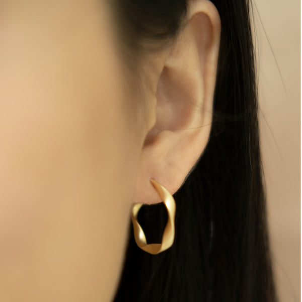 twisted gold hoops on women l Shop Lonna