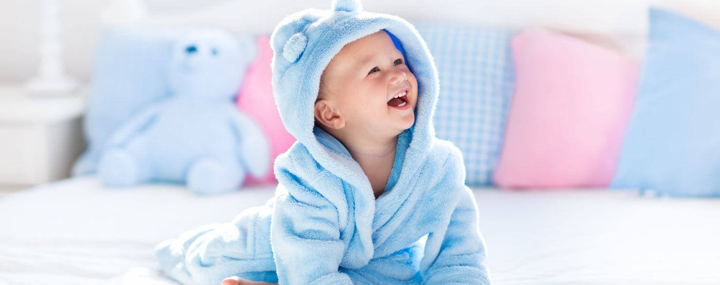 Baby boy smiling with bokeh effect background