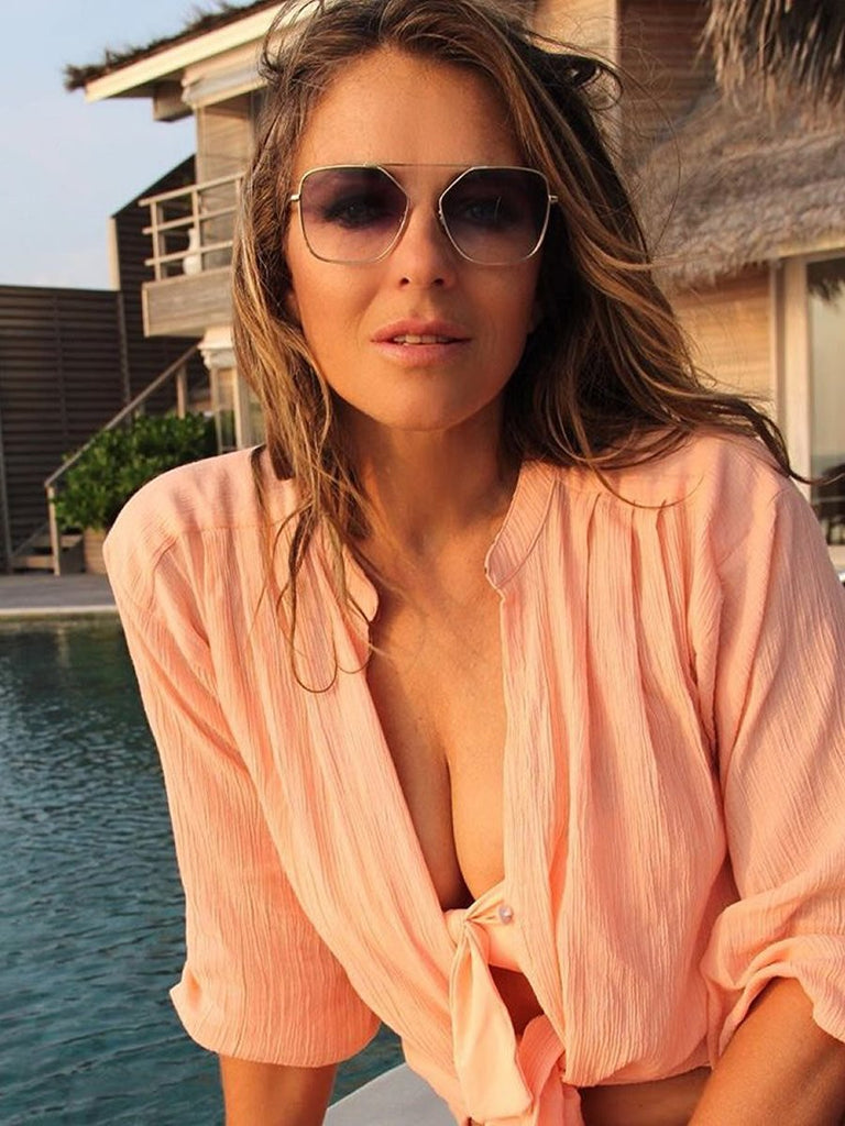 Elizabeth Hurley in Pink Shirt and Sunglasses
