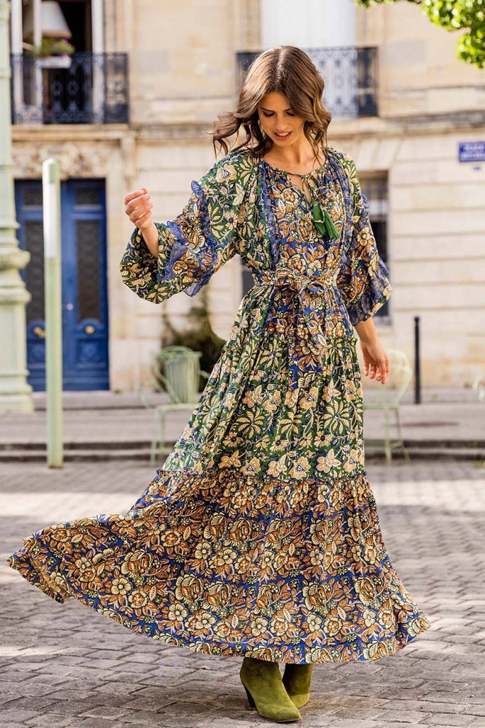 Brunette model spinning in a colourful boho maxi dress