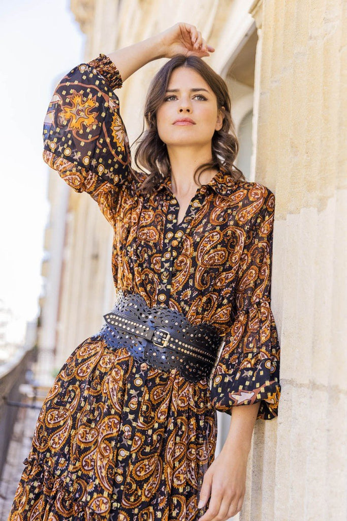 Model wearing brown and black boho maxi dress with wide leather belt
