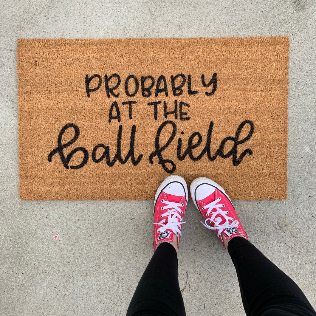 Probably at the ball field doormat