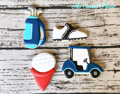 Golf Cart, Golf Bag, Shoe, Ball on Tee