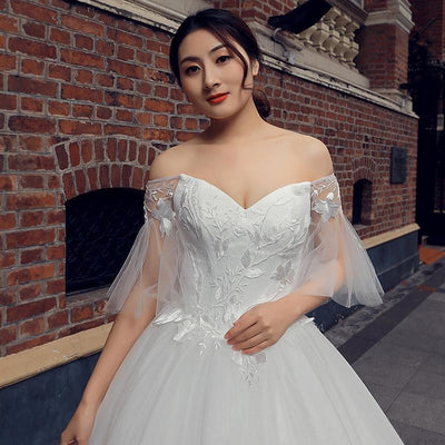 Off-Shoulder Bell Sleeved White Gown